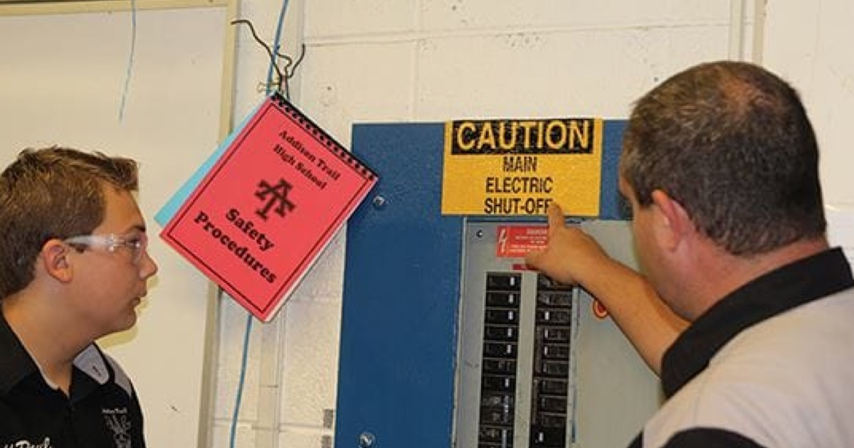 instuctor-teaching-student-about-safety-precautions